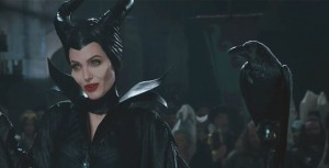 Maleficent (Angelina Jolie) causing mayhem with her feathered sidekick.